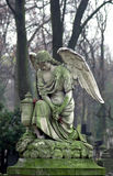 Angel. Statue of an angel at Powazki Cemetery (Warsaw, Poland) – the oldest and most famous cemetery in the country. The cemetery is also an impressive gallery Royalty Free Stock Photo