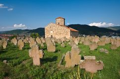 Cemetery of Serbian Orthodox Church of Holy Apostles in Novi Pazar, Serbia. NOVI PAZAR, SERBIA - 26 July: historical cemetery and 9th century Serbian Orthodox stock photos