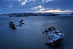 Cemetery of small fishing boats in Teriberke at sunrise. Murmans Royalty Free Stock Photos