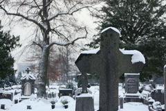 Cemetery snow. Cemetery during cold and snowy wintertime Stock Photo