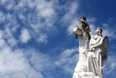 Cemetery Statue of an Angel and a cross. Looking to the sky stock image