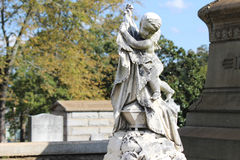 Cemetery Statues. Beautiful cemetery statues aligned in nature Royalty Free Stock Photography