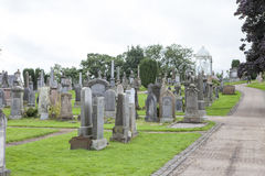 Cemetery in Stirling. Scotland, UK, with a view of Stirling castle Royalty Free Stock Photo