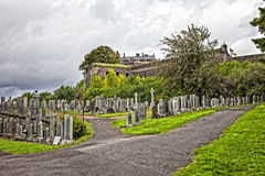 Cemetery in Stirling. Scotland, UK, with a view of Stirling castle Royalty Free Stock Photos