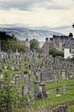 Cemetery in Stirling. Scotland, UK, with a view of Stirling castle Royalty Free Stock Photography