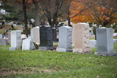 Cemetery Stones. Graves in the cemetery during the day Stock Images