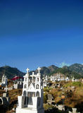 Cemetery in a sunny day of Oaxaca mountains. Cemetery in a sunny day with trees and white and in Oaxaca mountain ridge close to Tlaxiaco Royalty Free Stock Photo