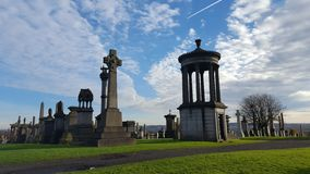 Cemetery with tombs and monuments. Glasgow cemetery with tombs and monuments royalty free stock photo