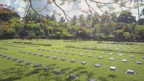 A cemetery tombstone with green fields