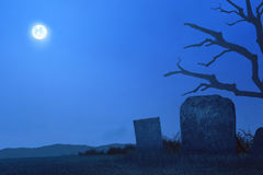 Cemetery with tombstones and creepy trees. At night Royalty Free Stock Photo