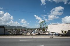 Damage to cemetery walls Caguas, Puerto Rico. Cemetery wall collapsed from the force of Hurricane Maria`s winds Stock Images