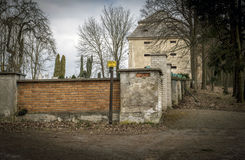 Cemetery wall with tower. Cemetery wall in woods with tower Royalty Free Stock Images
