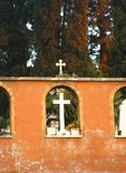 Cemetery walls. Close up view on monumental cemetery walls, with arcs and crosses Royalty Free Stock Images