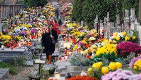 Cemetery in Warsaw. Warsaw, Poland - 1st November, 2008: People on Wola Cemetery at Wola district during All Saints Day in Warsaw Royalty Free Stock Photo
