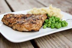Cena asada a la parilla del pollo Imagen de archivo libre de regalías