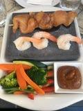Cena asada a la parrilla piedra Foto de archivo libre de regalías
