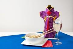 Cena china con el vino blanco Imagen de archivo libre de regalías