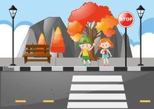 Cena com as crianças que cruzam a rua Foto de Stock