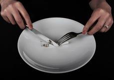 Cena con la sigaretta Immagine Stock