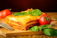 Cena con le lasagne al forno bolognese Fotografia Stock Libera da Diritti
