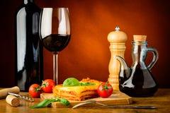 Cena con le lasagne al forno ed il vino rosso Fotografia Stock Libera da Diritti