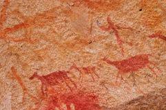 Cena da caça em pinturas de caverna antigas imagem de stock
