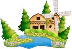 Cena da exploração agrícola com o celeiro pelo rio Imagem de Stock Royalty Free