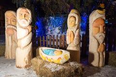 Cena da natividade do Natal com bebê Jesus, Mary e Joseph no celeiro Imagem de Stock