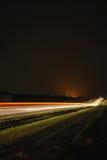 Cena da noite de linhas dos carros Imagem de Stock Royalty Free