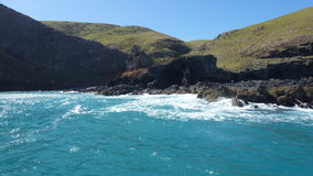 Cena da rocha em Akaroa, NZ Foto de Stock