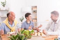 Cena de la familia con el padre Fotografía de archivo