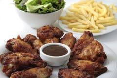 Cena de las alas de pollo imágenes de archivo libres de regalías