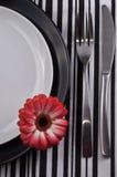 Cena de las placas con la fork y el cuchillo Imagen de archivo libre de regalías