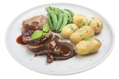 Cena del cordero con las nuevas patatas Fotos de archivo