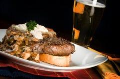 Cena del filete y de la patata Imagen de archivo