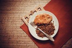 Cena del pollo y del alforfón imagen de archivo