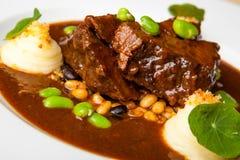 Cena della carne di maiale dei peperoncini rossi fotografia stock