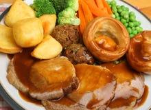 Cena di domenica dell'arrosto di maiale Immagini Stock Libere da Diritti