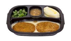 Cena di TV congelata dei tortini del pollo fritto Fotografia Stock
