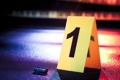 Cena do crime fresca com a fita amarela na noite Fotografia de Stock Royalty Free