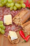 Cena rústica del queso y del pan Fotos de archivo libres de regalías