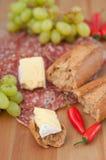 Cena rústica del queso y del pan Imágenes de archivo libres de regalías
