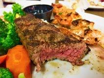 Cena rara arrostita della bistecca di striscia di New York Fotografia Stock