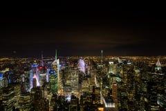 Cenas da noite de skylines de NYC Fotografia de Stock Royalty Free