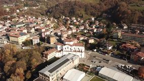 Cene, Bergamo, Italy. Drone aerial view of the city. During autumn stock footage