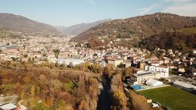 Cene, Bergamo, Italy. Drone aerial view of the city. During autumn stock video footage