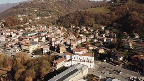 Cene, Bergamo, Italy. Drone aerial view of the city. During autumn stock video