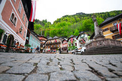 Cenic Picture-postcard View Of The Historic Town Square Of Hallstatt With Traditional Colorful Houses And Church At Hallstatter Se Stock Photo