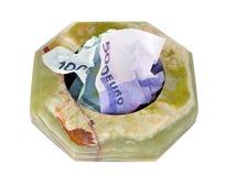 Cenicero con el dinero Imagen de archivo