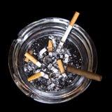 Cenicero con los cigarrillos y el tabaco Imagen de archivo libre de regalías